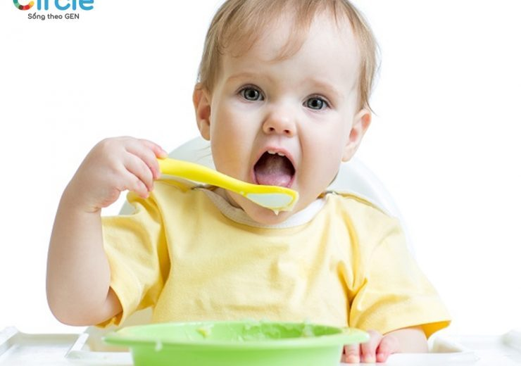 baby child eating healthy food with a spoon